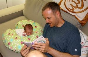 newborn daddy reading